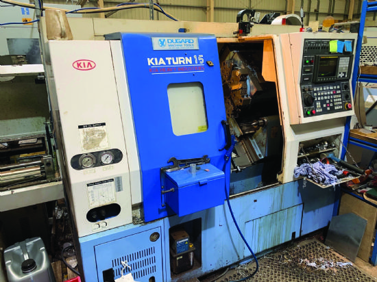 """8"""" chuck,  tailstock,  parts catcher,  swarf conveyor & mag bar feed,  tooling.  YOM 2005"""