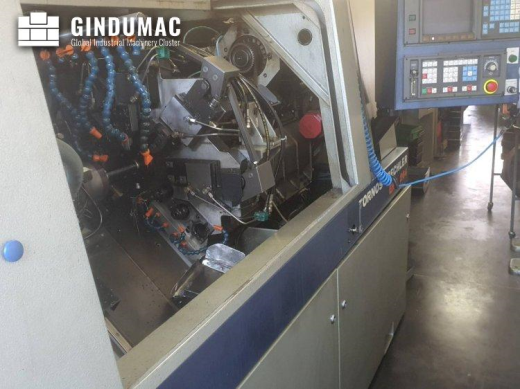 This Tornos-Bechler ENC 264 Sliding Headstock Lathe was made in Switzerland in 1993. It is equipped