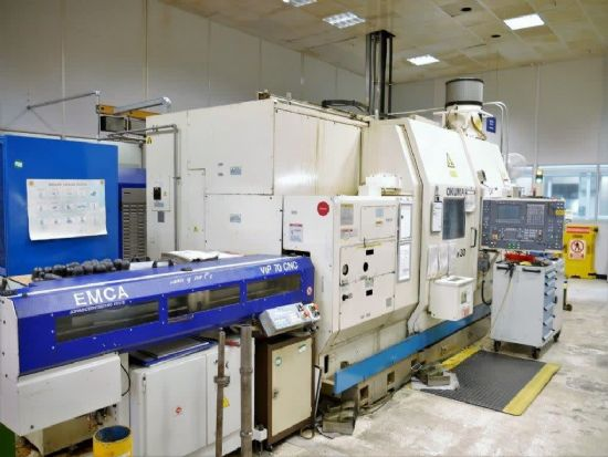 OSP 7000L CNC, 5 axis, milling, 80mm bore, speeds to 4500rpm, H2 swivelling head with 20 tools, 500